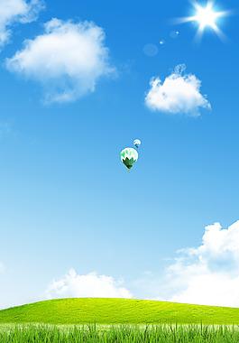 白云草地背景藍天